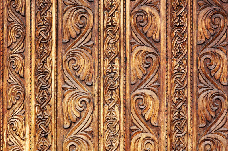 Old hand-carved wooden pattern on a monastery door. From Romania, with beautiful, traditional textures stock photo