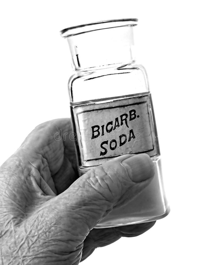 Old Hand Holding Bicarb Bottle royalty free stock photo