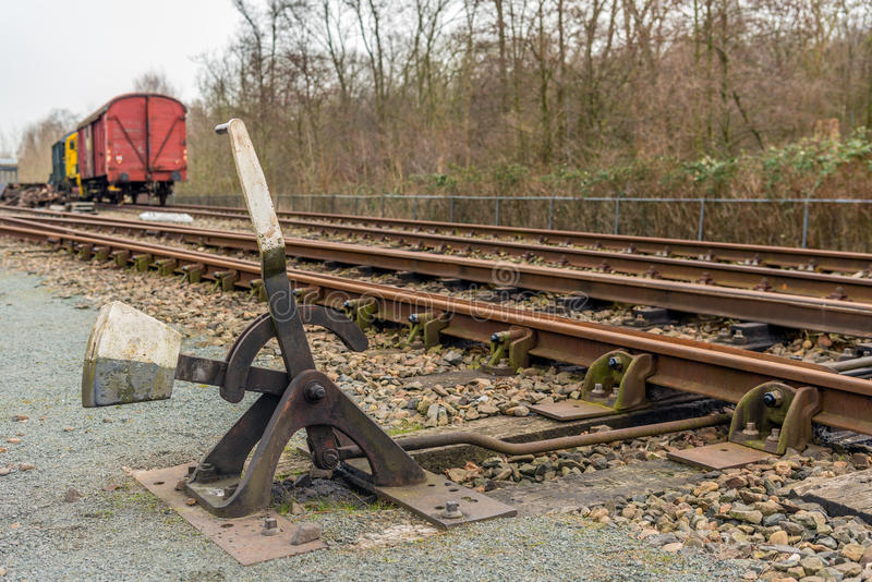Old hand-operated railroad switch. Old hand-operated lever of a railroad switch in the Netherlands stock image