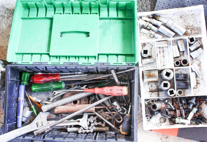 Old  hand tools in car mechanic box top view royalty free stock photos