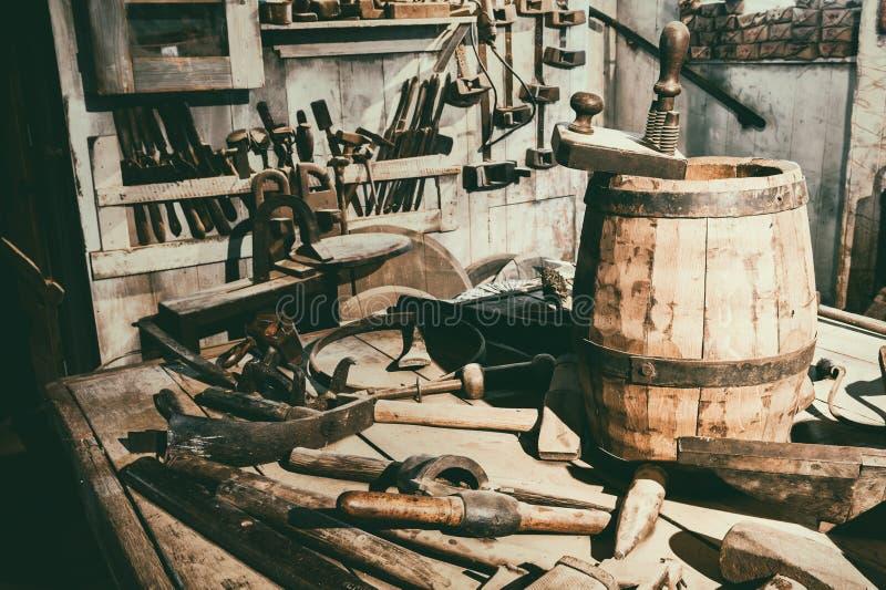 Old hand tools in vintage workshop stock images