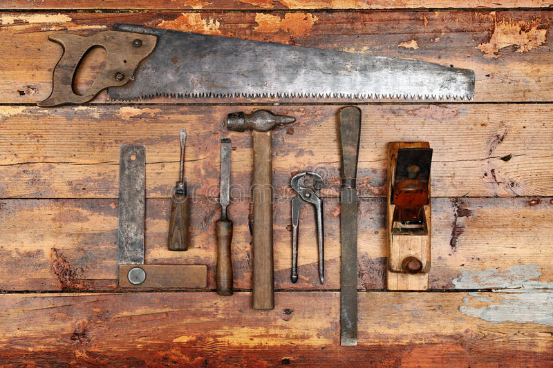 Old hand tools on wooden background royalty free stock images