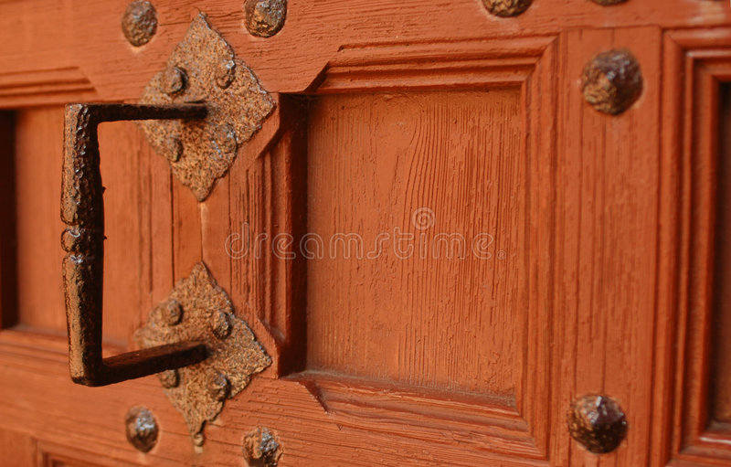 Old handle. Rusty, old handle on very old gothic doors royalty free stock images