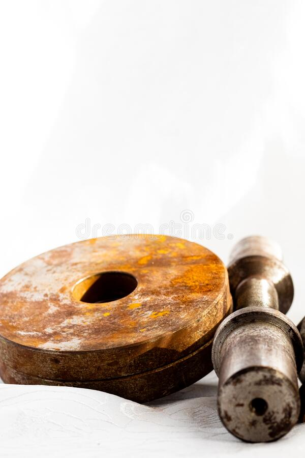 Old handmade dumbbells and discs with patina and rust. Rusty dumbbell. Sports, fitness equipment and accessories stock photography