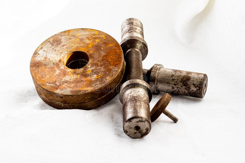 Old handmade dumbbells and discs with patina and rust. Rusty dumbbell. Sports, fitness equipment and accessories royalty free stock photo