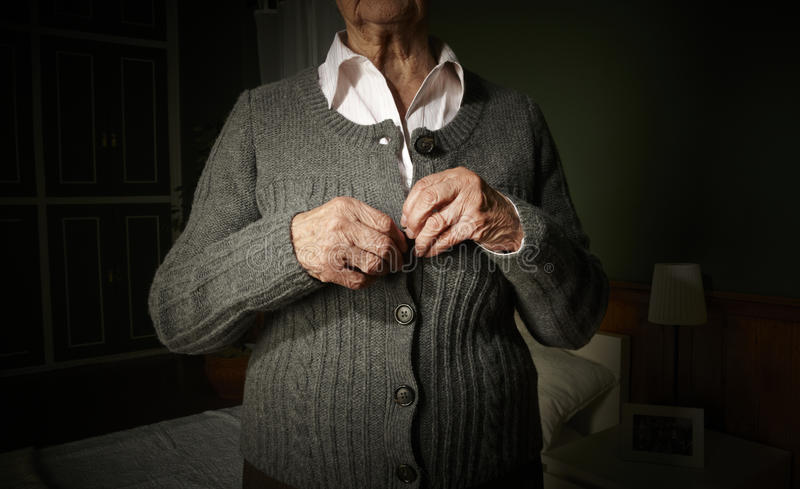 Old hands buttoning. royalty free stock images