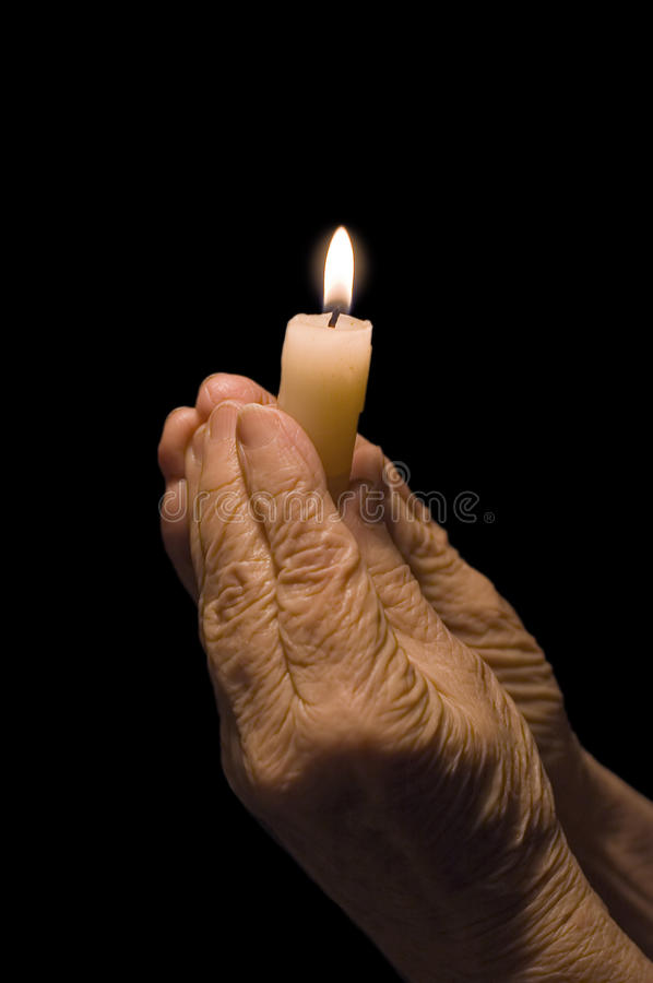Old Hands With A Candle Royalty Free Stock Photo
