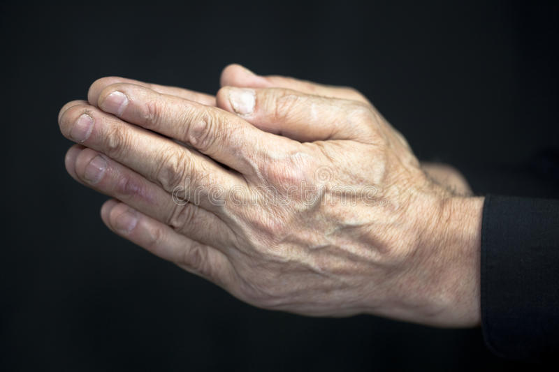 Old hands praying stock images