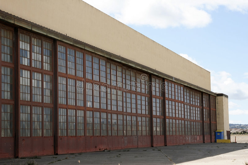 Old Hangar. Old abandoned airplane hangar with doors shut stock photography