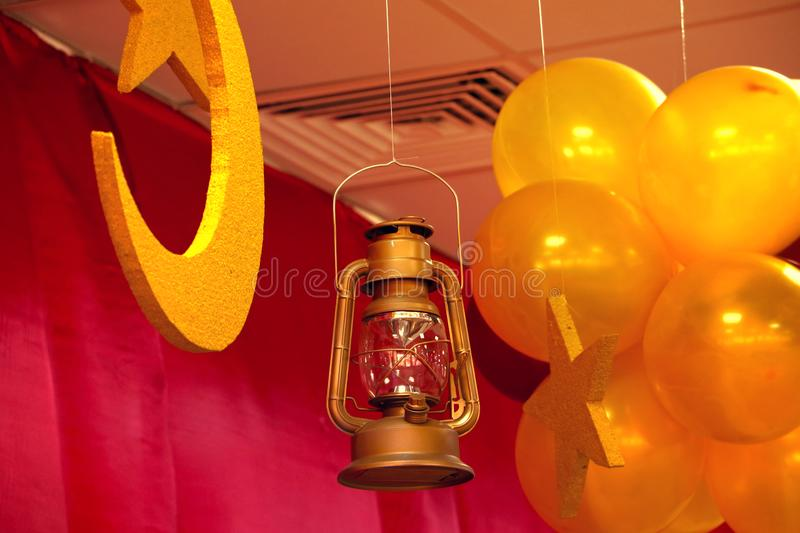 Old hanging lantern, lighted A vintage oil lamp with protective covers hanging from the ceiling,Dubai 28th may 2017. Vintage or retro lamp on old wall in home stock photography