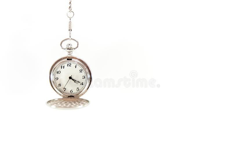 Old, hanging pocket watch isolated on white background. Old, functional, silver, hanging pocket watch isolated on white background royalty free stock photos