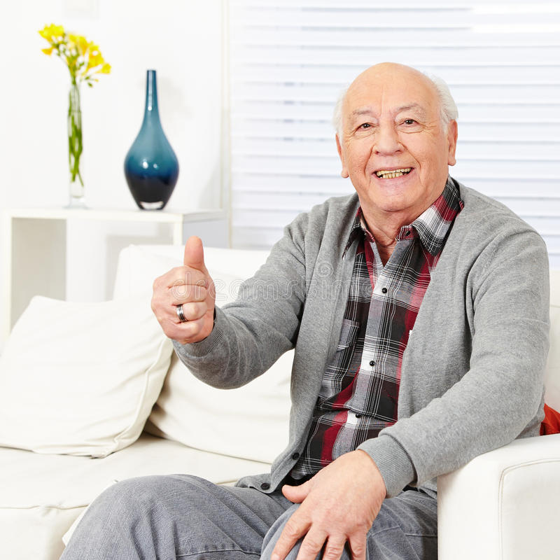 Old happy man holding thumbs up stock photography