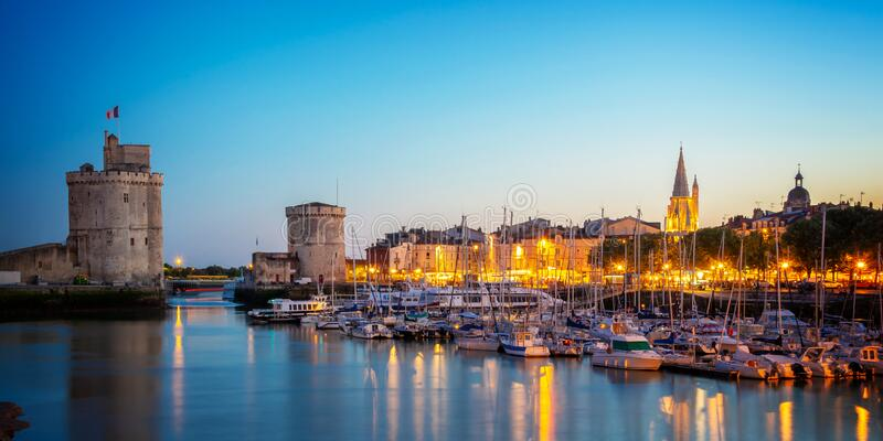 Old harbor of La Rochelle France at night. Old harbor of La Rochelle, France at night royalty free stock photography