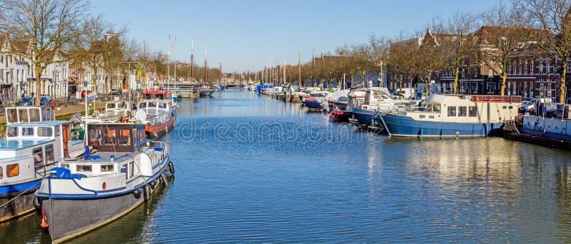 Old harbor in Vlaardingen, Netherlands. Winter morning blue water in the old harbor in Vlaardingen, Schiedam, Netherlands stock image