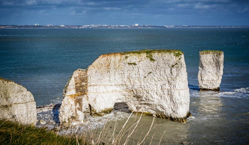 Old Harry Rocks with Bournemouth in the background near Swanage, Dorset, UK. On 21 February 2014 royalty free stock photos