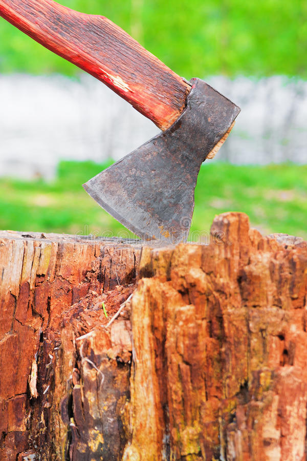 Old Hatchet In Wooden Log Stock Photography