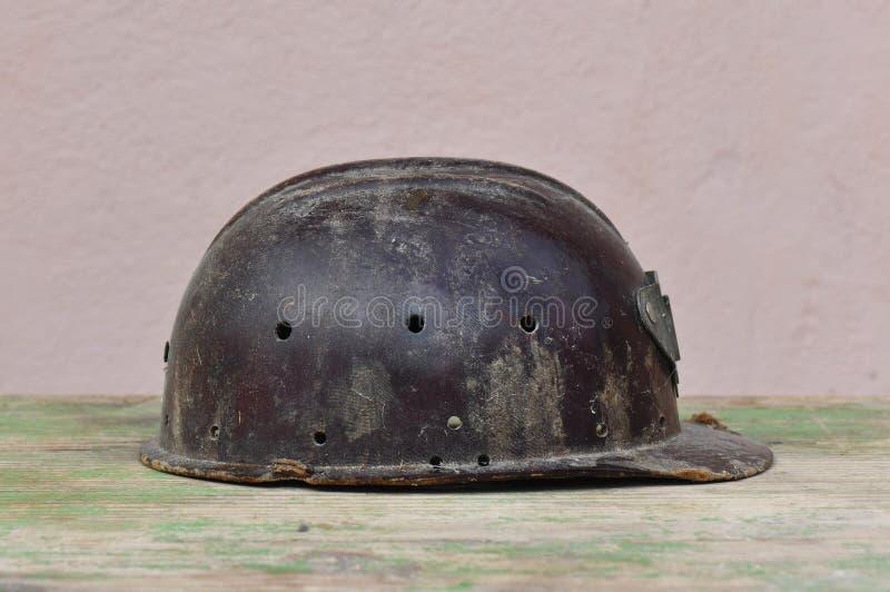 Old helmet of miner stock images