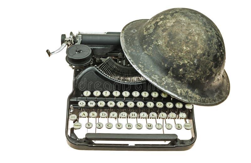 Old helmet on the old typewriter. Old british WW II helmet (MKII) on the old, black typewriter royalty free illustration