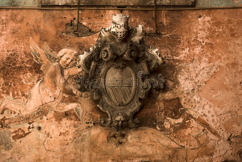 Old heraldic emblem with angels. Kotor Montenegro royalty free stock photography