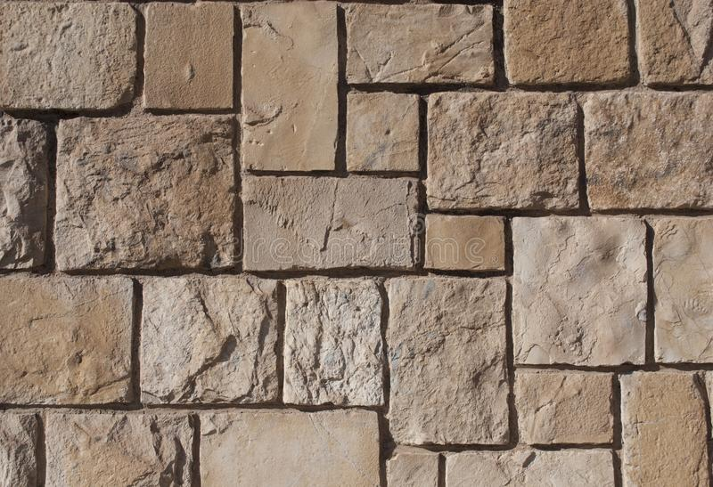 Old hewn stone wall, beautiful background texture stock photography