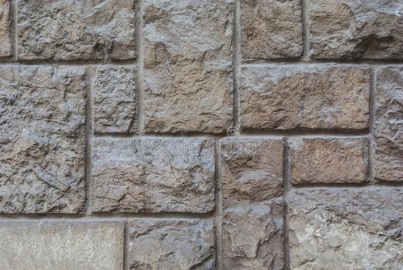 Old hewn stone wall, beautiful background texture royalty free stock images