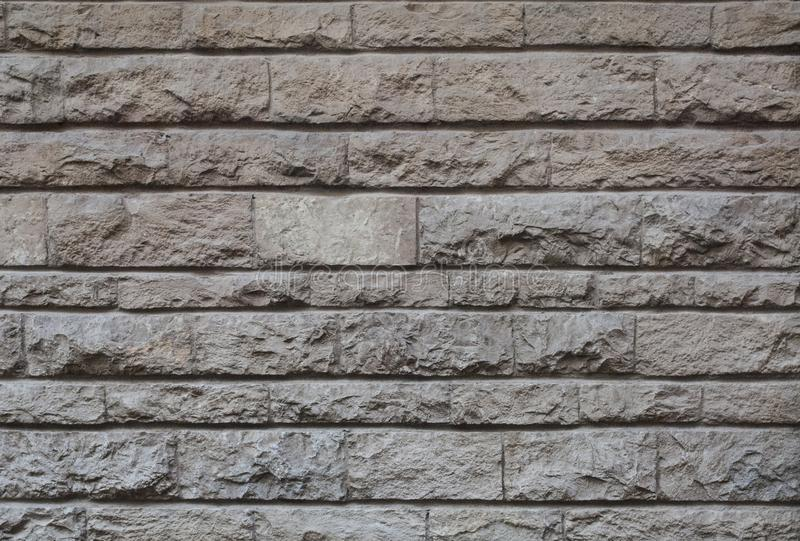 Old hewn stone wall, beautiful background texture royalty free stock image