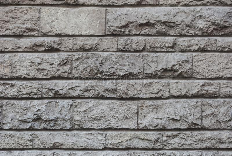 Old hewn stone wall, beautiful background texture stock image