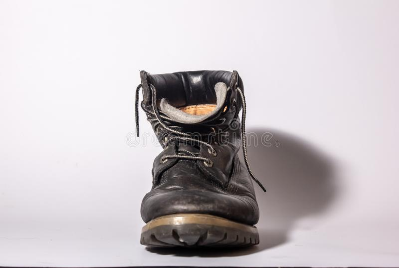 old high shoe now deformed, brown-colored boot now worn. stock images