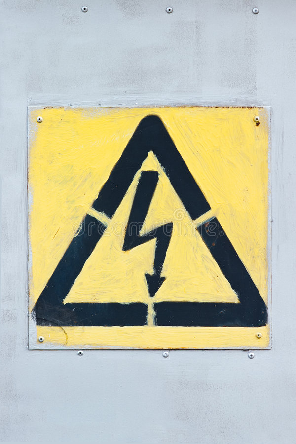 Old high voltage sign royalty free stock photo