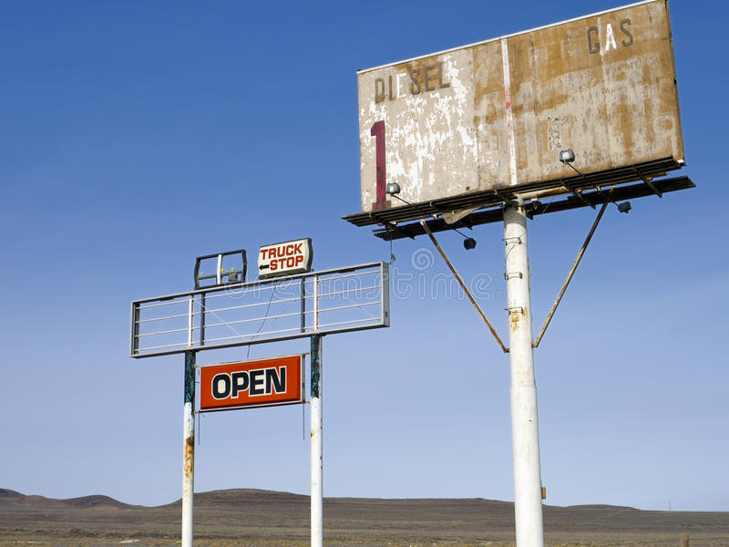 Old highway signs in the Nevada desert. Old truck stop signs along the highway in the Nevada desert stock photos