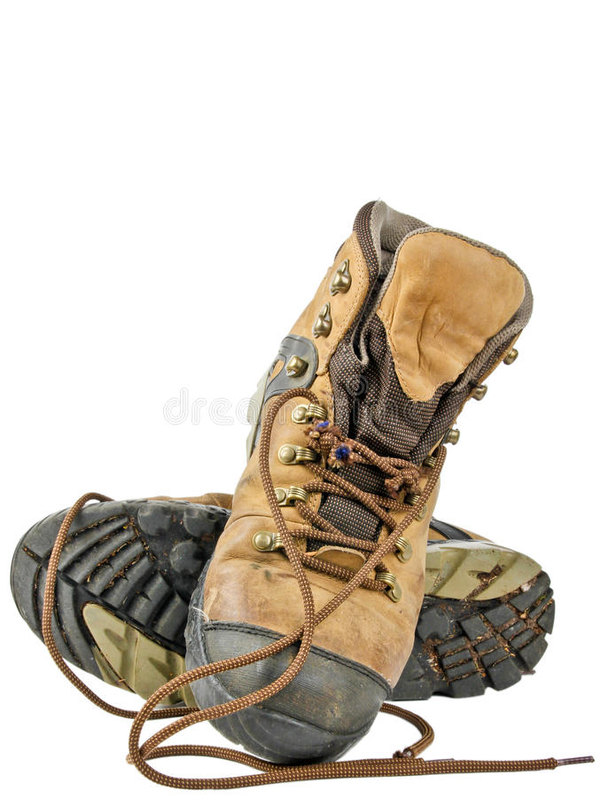 Old hiking boots. Close up on white background stock image