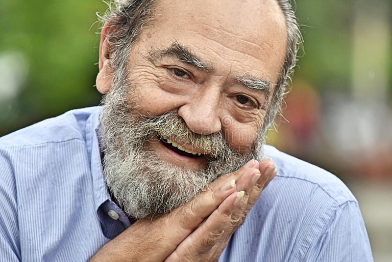 Appreciative Male Grandfather. An old hispanic senior man royalty free stock photography
