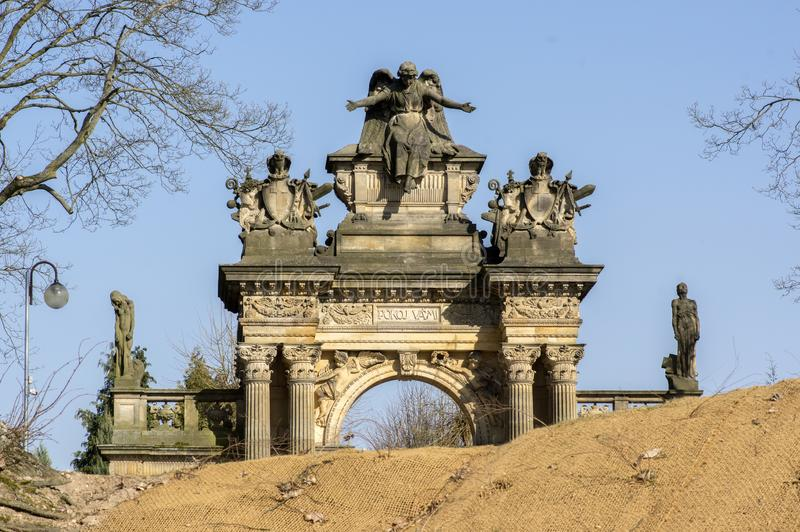 Old historic amazing neo-renaissance style cemetery portal in Horice in Czech republic, sunny day. Blue sky stock image