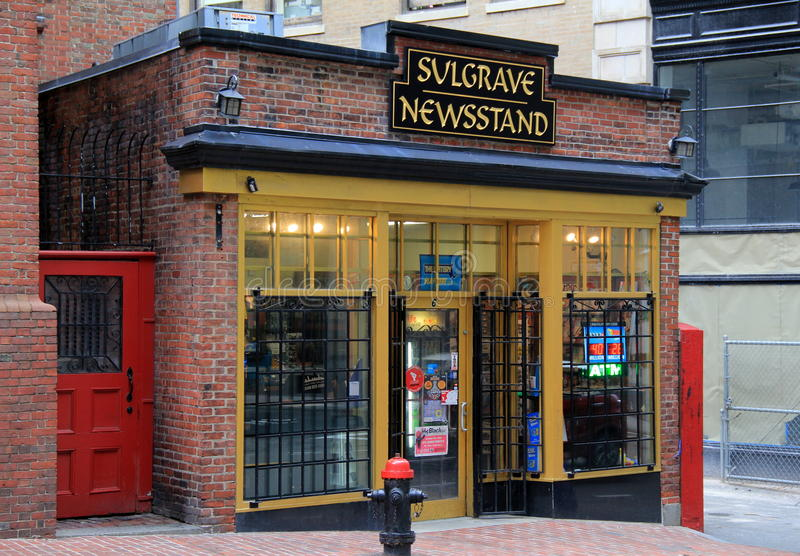 Old, historic brick storefront of Sulgrave Newsstand in the heart of Boston, Massachusetts,Fall,2014. Old,historic brick and wood storefront, tucked between royalty free stock image