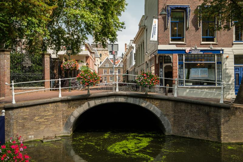 Old historic bridge, the Boterbrug, with flowers on the railing, in Dellft, the Netherlands stock photos