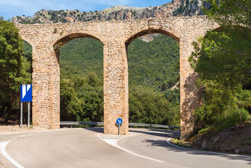 Old historic bridge in Mallorca. Old historic bridge over the road in Mallorca. Baleares, Spain stock photo