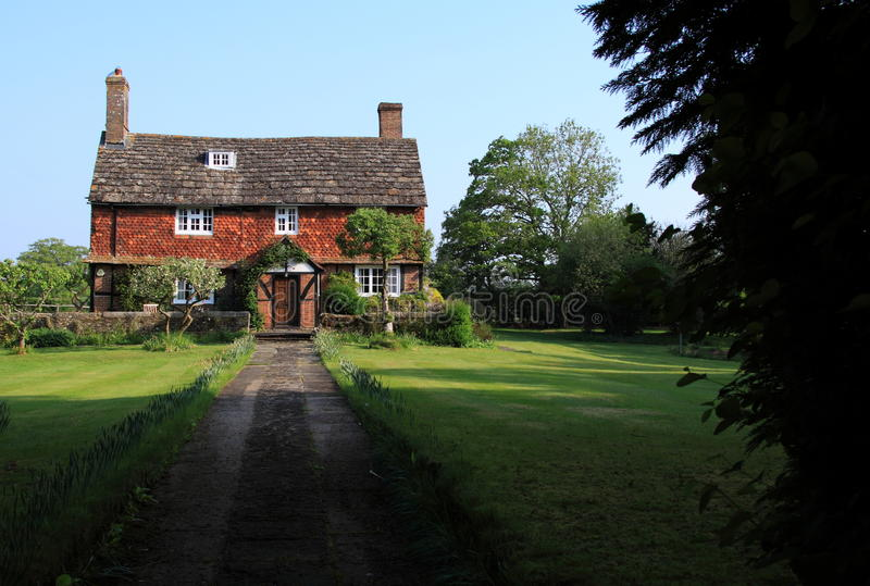 Old historic English farmhouse. 16th century timber-framed beamed house in a rural village in Sussex, England, is a Grade II listed building with traditional stock photos
