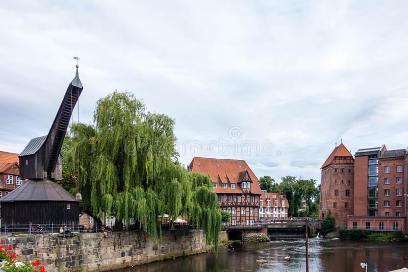 Old historic harbor of Luneburg with half-timbered houses and crane an river in Schleswig-Holstein Germany royalty free stock photos