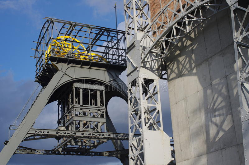 Old historic lift towers of mining industry. Historic `KWK Poland` lift towers in Swietochlowice in industrial Upper Silesian region in Poland stock photo
