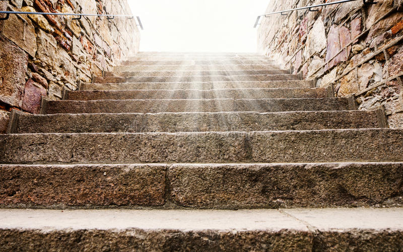 Old historic stone stairs, leading up to the sun lights. Shot at Castell De Montjuic, Barcelona, Spain royalty free stock photo