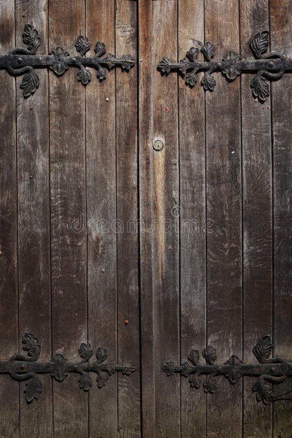 Old historic wooden decorated doors, background royalty free stock images