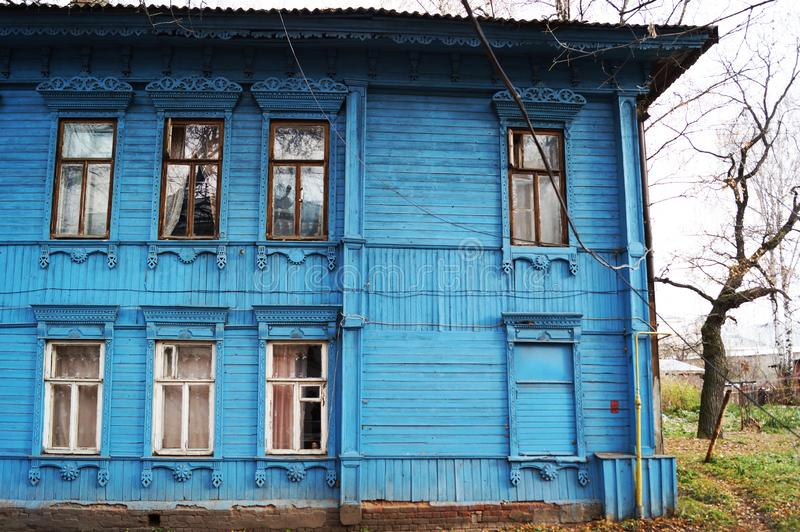 Old historical blue wooden building. NRussian wooden blue house stock photo