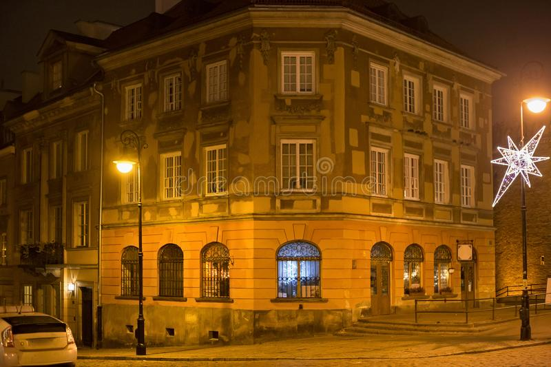 Old historical building on the Mostowa street in Warsaw at winter night. royalty free stock images