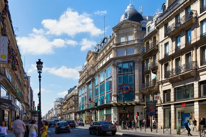 PARIS, FRANCE - JUNE 23, 2017: Old historical buildings in central part of Paris on the Rue de Rivoli at summertime. Old historical buildings in central part of royalty free stock photo