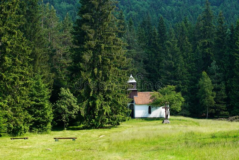 Old historical Chapel in the forest stock photography