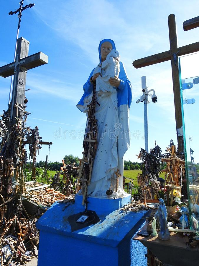 Cross and holy Mary in Cross hill near Siauliai town, Lithuania stock images