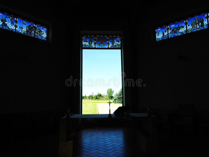 Cross in Cross hill near Siauliai town by new church window, Lithuania stock images