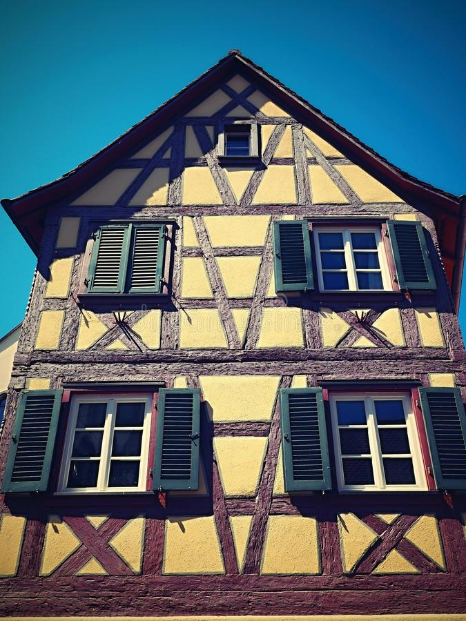 Old historically romantic house with interesting background. Nice colored,blue sky,historic buildings stock photo
