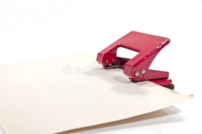 Old Hole Punch With Old Paper Stock Image