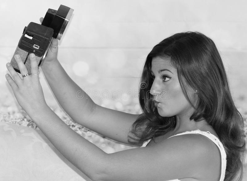 Old Hollywood Selfie. Young women with vintage camera, black and white